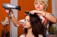 Hairdresser making hair stock image