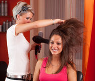 Hairdresser making hair of beautiful teenage girl Stock Photography