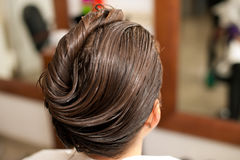 Hairdresser making hair treatment to a customer in salon Royalty Free Stock Photos