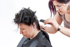 Hairdresser making haircut Stock Photo