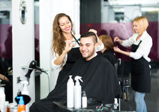 Hairdresser making haircut in hair studio Stock Images