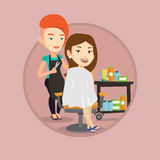 Hairdresser making haircut to young woman. Royalty Free Stock Images