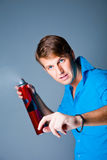 Hairdresser man with hairspray Stock Image