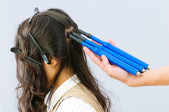 Hairdresser with plait-maker Stock Image