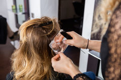 Hairdresser Putting Foils In Female Client's Hair Royalty Free Stock Image