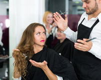 Hairdresser quarrels with the female client Stock Image