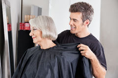 Hairdresser Removing Client's Apron After Haircut Stock Photography