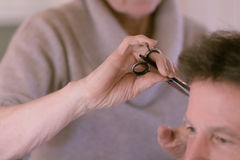 Hairdresser's hand and scissors stock image