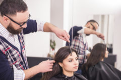 Hairdresser's. Professional hairdresser making hair for a brunette girl in hairdresser salon Royalty Free Stock Photo