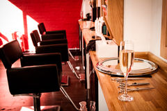 Hairdresser's salon. At the hairdresser's: a glass of champagne to welcome clients royalty free stock image