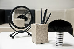 Hairdresser's salon. Mirror, combs, and a brush at a hairdresser salon Stock Photo