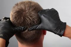 Hairdresser`s salon head massage, master`s hands stock images