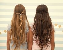 Hairdresser salon services. two little girls kids with long hair at hairdresser. little girls with long curly hair. long. And healthy hair. kertatine mask stock photo