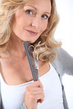 Hairdresser with scissors. And comb stock images