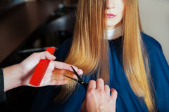 Hairdresser with scissors and comb Stock Photos