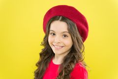 Hairdresser service. Kid girl long healthy shiny hair. Perfect curls. Kid cute face with adorable curly hairstyle wear. Beret hat. Little fashionista. Little royalty free stock photo