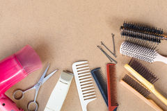 Hairdresser set with comb on top of background. Royalty Free Stock Photo