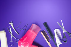 Hairdresser set with comb on top of purple background. Stock Photo