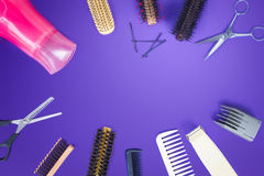 Hairdresser set with comb on top of purple background. Stock Photos
