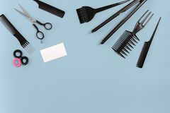 Hairdresser set with various accessories on blue background Royalty Free Stock Images