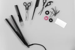Hairdresser set with various accessories on gray background. Top view. Still life. Flat lay Royalty Free Stock Photo