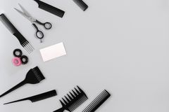 Hairdresser set with various accessories on gray background. Top view. Still life. Flat lay. Copy space stock photography