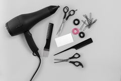 Hairdresser set with various accessories on gray background