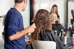 Hairdresser Setting Up Client's Hair Stock Photos