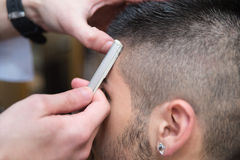 Hairdresser Shaving Man's Chin With A Straight Razor Stock Images