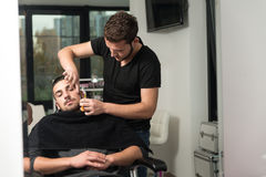 Hairdresser Shaving Man's Chin With A Straight Razor Stock Photo
