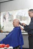 Hairdresser Shaving Man's Head With Electric Razor Royalty Free Stock Image