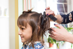 Hairdresser shears girl Royalty Free Stock Photos