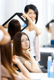 Hairdresser showing the haircut of client in mirror Royalty Free Stock Photography