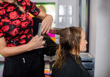 Hairdresser Styling Hair Of Customer In Beauty Salon Royalty Free Stock Images