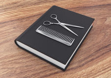 Hairdresser tool on a book Royalty Free Stock Photo