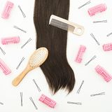 Hairdresser tool for hair styling on white background. Beauty composition. Flat lay, top view. Hairdresser tool for hair styling on white background. Beauty Royalty Free Stock Photos