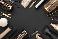 Hairdresser tools on black background with copy space in center.  royalty free stock photo