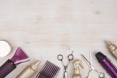 Hairdresser tools on wooden background with copy space at top.  stock photography