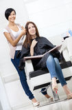 Hairdresser tries strand of dyed hair on the client Royalty Free Stock Images