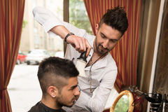Hairdresser Trimming Black Hair With Scissors Stock Photography