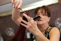 Hairdresser Trimming Ends Stock Image