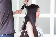 Hairdresser use perm rods Royalty Free Stock Photography