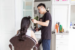 Hairdresser use perm rods Royalty Free Stock Image