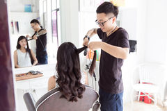 Hairdresser use perm rods Stock Photos