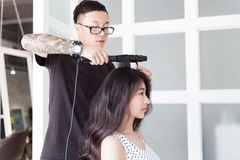 Hairdresser use perm rods Stock Photo