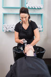 Hairdresser washing clients hair Stock Photos