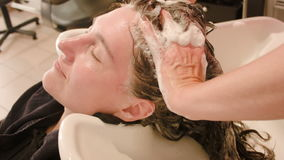 Hairdresser washing head client stock footage