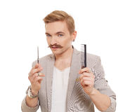 Hairdresser, wearing jacket, posing with scissors. Guy cutting his mustache royalty free stock photo