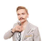 Hairdresser, wearing jacket, posing with scissors. Guy cutting his mustache Stock Photography