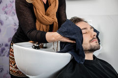 Hairdresser Wiping Male Client's Hair In Salon Stock Photos